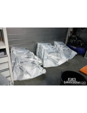 New frames, still in the factory bubble wrap, are marked with each rider's name