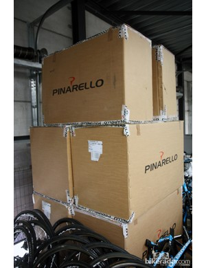 Boxes of new Pinarello frames are stacked nearly to the ceiling