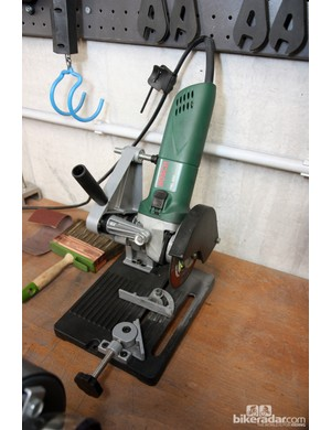 Sky team mechanics don't trouble themselves with hacksaws when cutting steerer tubes. This rotary saw gets the job done much quicker