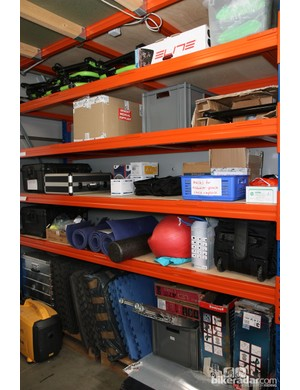 Stationary trainers, padded floor mats, foam rollers, exercise balls and other gear is stacked from wall to wall and floor to ceiling