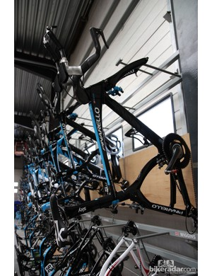 Dozens of Pinarello Graal time trial bikes - at a cost of over US$8,000 for each frameset - are mounted on the wall inside the Sky service course