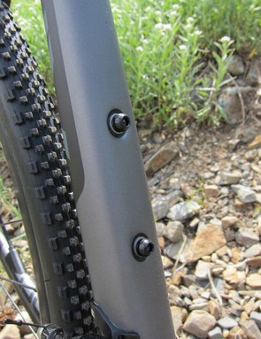 The recessed bottle bolt bosses allow summer bottle cages whose mounts disappear in the fall