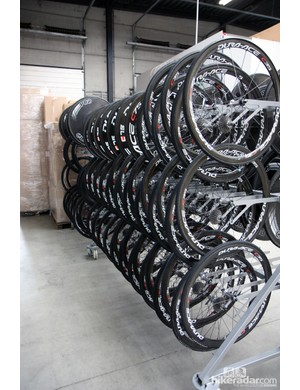 Someone out there is already calculating the retail value of this rack of wheels inside Sky's service course