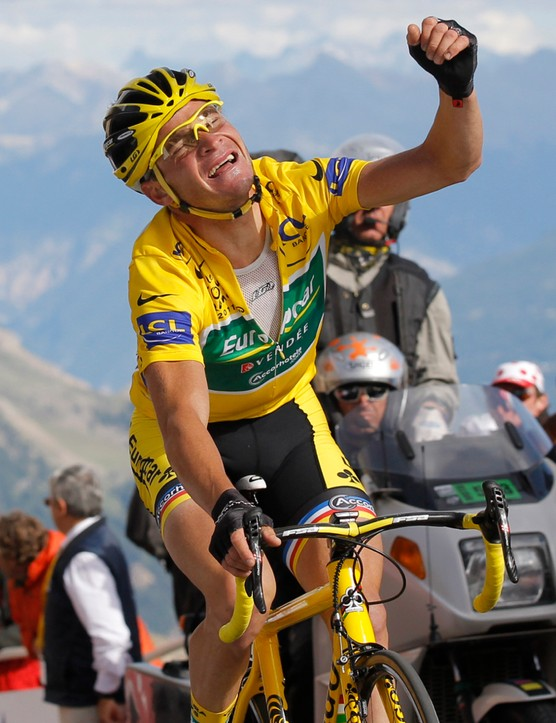 Did he win? No. But Voeckler celebrates keeping the yellow for another day as he crosses the line atop the Galibier on stage 18 of the 2011 Tour de France