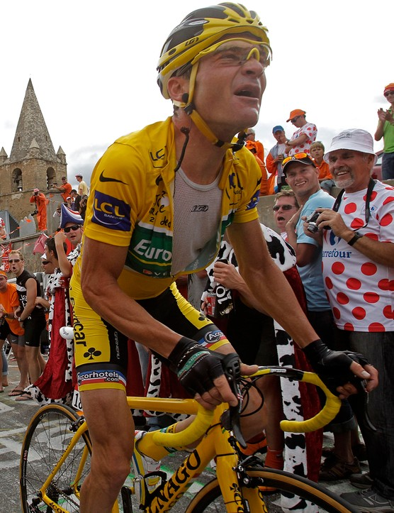 Voeckler suffers as Andy Schleck rides away, taking the race lead with him, on stage 19 of the 2011 Tour de France