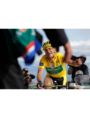 Voeckler rides into the arms of a team staffer after crossing the finish line on the Galibier