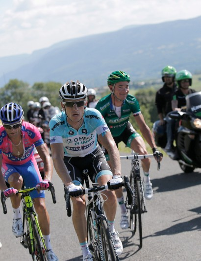 While his breakmates focus on the task at hand, Voeckler mugs for the camera