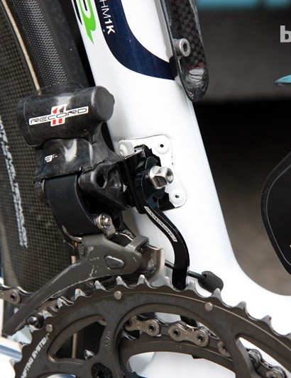 The Campagnolo Record EPS front derailleurs are supplemented with aluminum chain catchers on Movistar's Pinarello Dogma 2 machines.