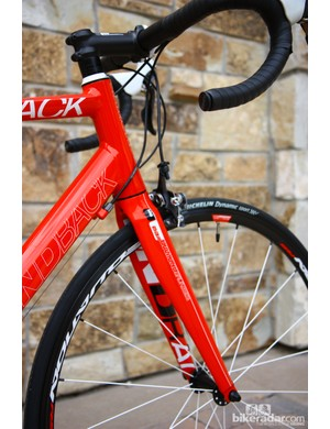 The alloy Diamondback Podium 4 features a tapered head tube. Ignore the 'Mg' decal on the fork, though. The factory couldn't figure out how to make a magnesium steerer tube pass testing standards, so production bikes feature a heavier - but more reliable - alloy one instead