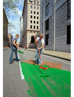 While some Green Lanes are painted green, the concept just refers to space between bike lanes and car lanes