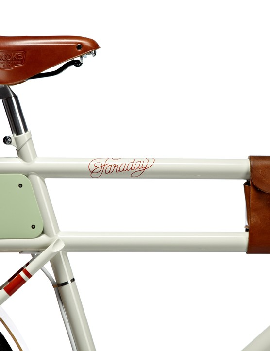 Battery at the rear with leather accessory pouch on the dual top tube