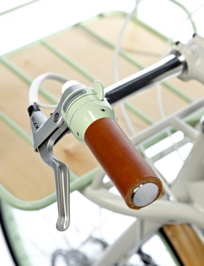 The green thumb lever engages the motor