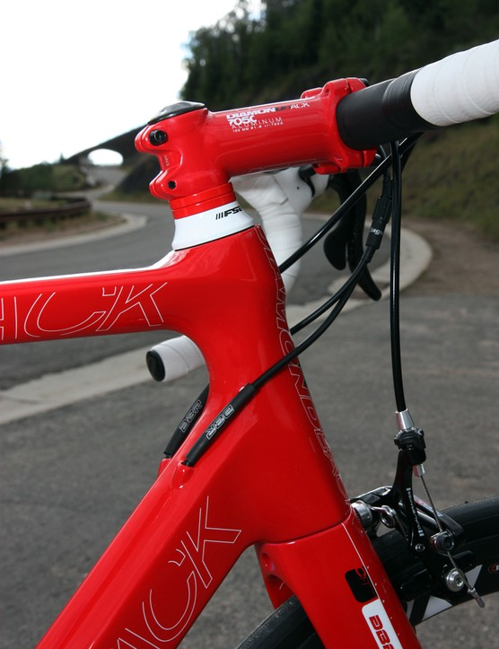 The internally routed derailleur cables are fed into the down tube just behind the tapered head tube