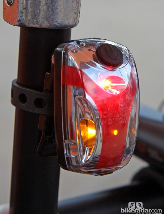 New for 2013 from Light & Motion is the Vis 180 Micro rear flasher with a 250-lumen central red LED emitter and twin amber side markers