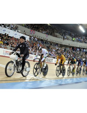 A derny motorpaces the riders in the keirin