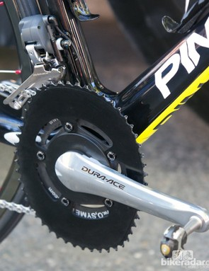 Outer view of the SRM mounted Osymetric rings, and also a black chain catcher fitted to the front derailleur clamp bolt