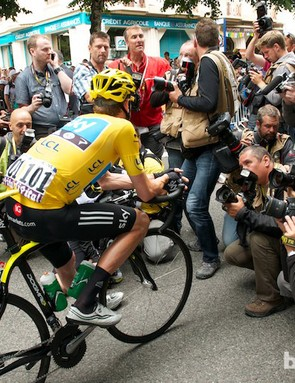 Wiggins surrounded by the race media before the start from Bagneres de Luchon on stage 17