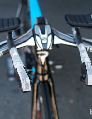 Michael Rogers' time trial bars had more extensive white grip tape applied to them and a fairly wide hand position