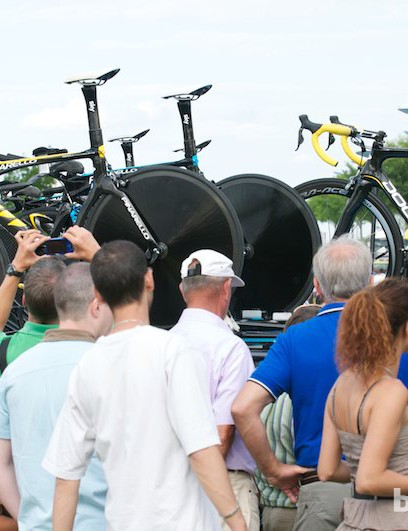Crowds flocking to the Team Sky cars and Wiggins's time trial bikes after the stage finish