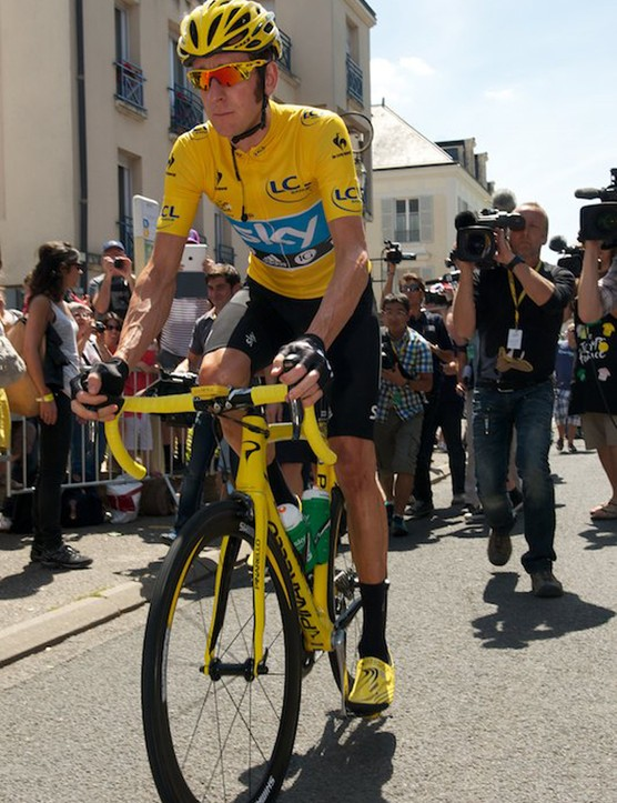 Wiggins on his way to sign on for the final time at the 2012 Tour. Note the change to Shimano badged wheels and different hubs for the final stage. Also special yellow Bont shoes and ventilated yellow Kask helmet