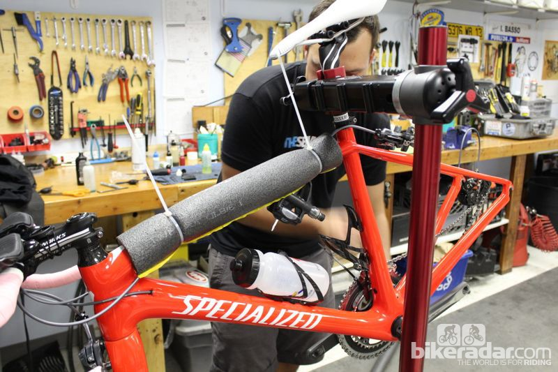 Shanks secures the pedals to the padded top tube with zip ties