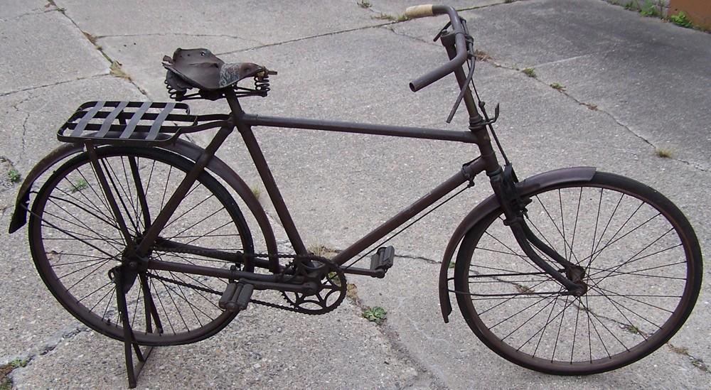 A rare surviving example of a World War II Japanese military bicycle with original wartime rubber tires
