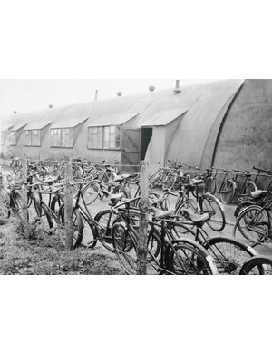 A few of the several hundred bicycles used for transportation on a WWII U.S. Bomber Station, parked outside the sergeant's mess during a cloudy day in England on Dec. 29, 1943