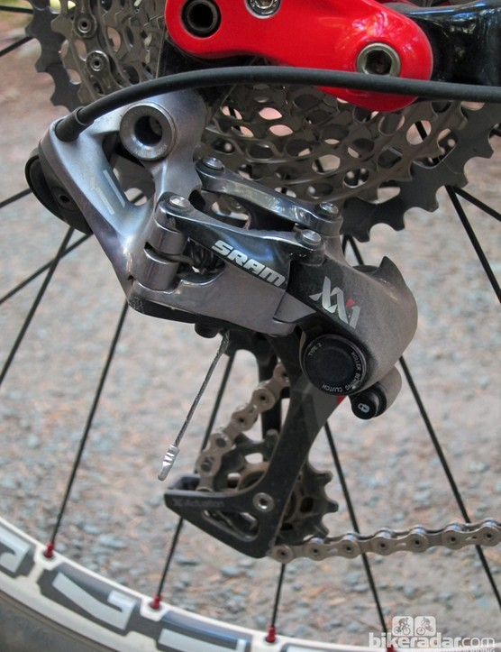 The new SRAM XX1 rear derailleur uses what the company calls a 'straight P' geometry, with no slant to the parallelogram. According to SRAM, this results in fewer ghost shifts in bumpy terrain. Proper chain gap is ensured by the massively offset upper pulley