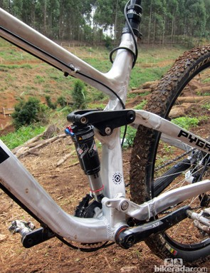 The rear shock is anchored between floating linkages for a more tunable spring rate