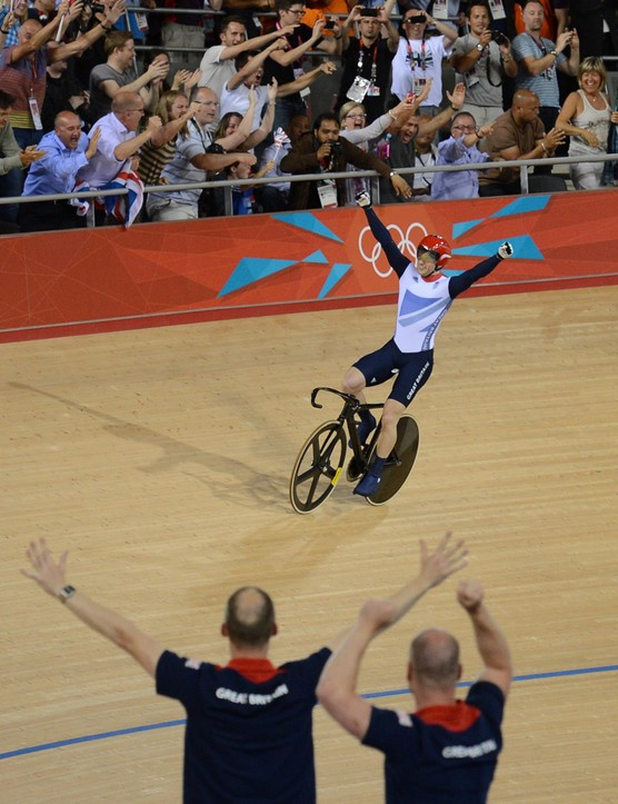 Jason Kenny and Team Great Britain celebrate winning the Olympic sprint