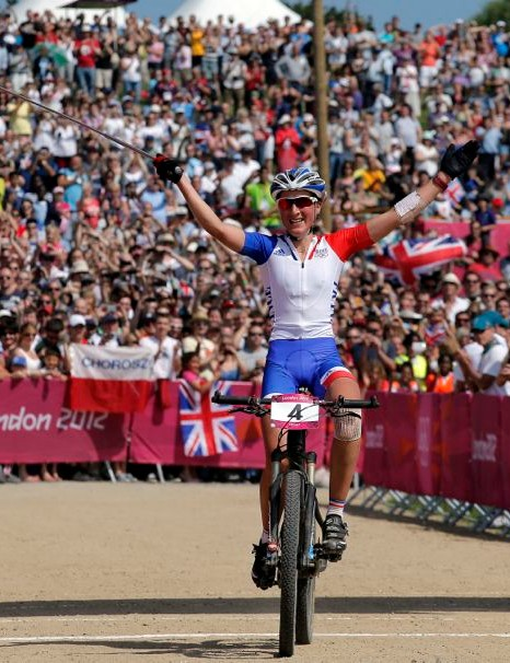 Julie Bresset celebrates winning the Olympic mountain bike race