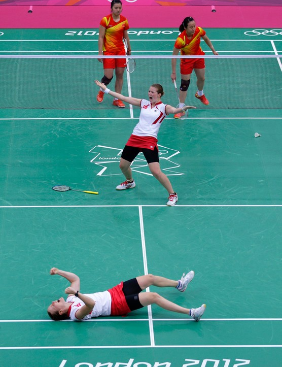 Denmark's Kamilla Rytter Juhl and Christinna Pedersen celebrate after beating a Chinese pair in a doubles badminton match