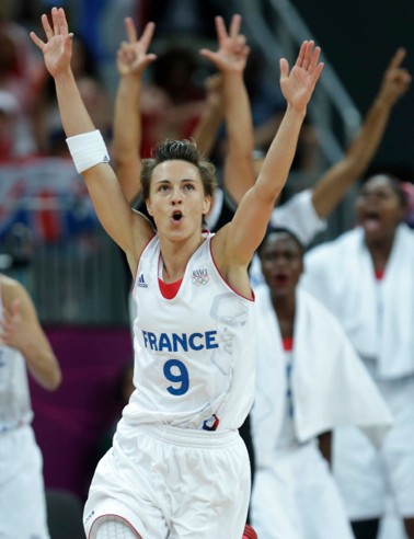 Celine Dumerc celebrates her game-winning 3-point basket with less than a second remaining in overtime to defeat Britain