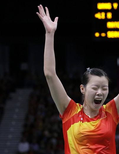 Li Xuerui celebrates winning the Olympic singles badminton