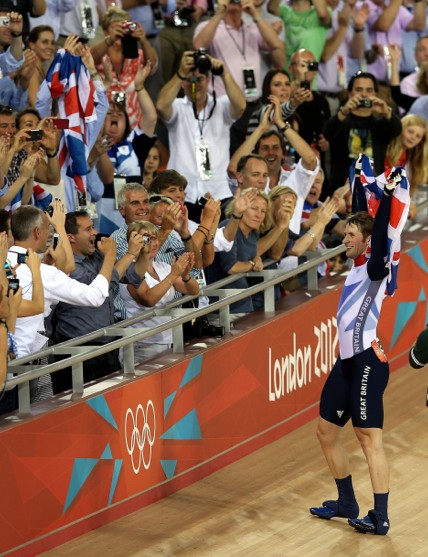 Jason Kenny celebrates winning the Olympic sprint