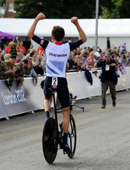 Bradley Wiggins celebrates winning the Olympic time trial