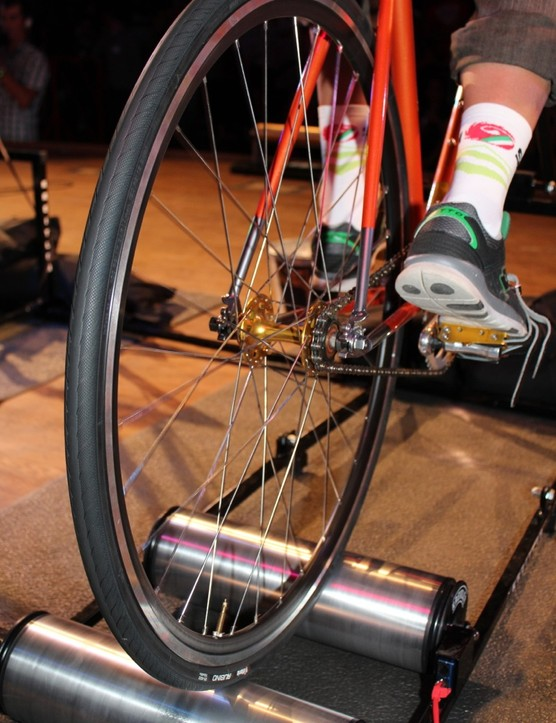 The fixed-gear bikes can move freely at the rear - and even slide off the rollers