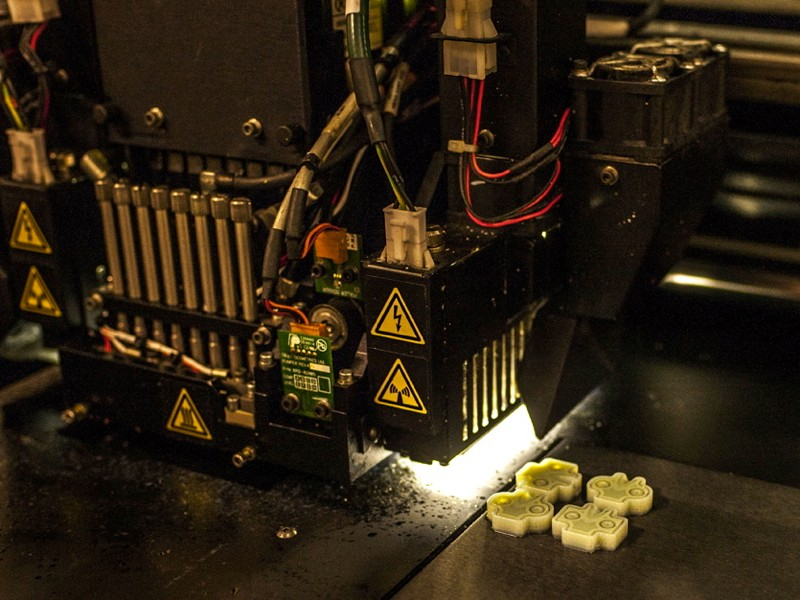 Trek's 3D printer in action, laying down layer upon layer of plastic