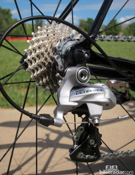 The Shimano Ultegra rear derailleur is bolted to a replaceable aluminum hanger