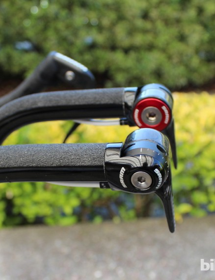 Nibali offers for skateboard-style grip tape over handlebar tape, with return-to-center SRAM levers set in the down position to meet UCI extension rules