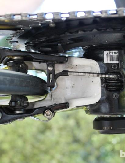 Cannondale tucks the same brake underneath the bottom bracket for the rear wheel