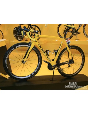 The bike Brad Wiggins won this year's Tour de France on, the Pinarello Dogma 65.1 Think 2 in yellow, was taking pride of place on the Italian firm's stand