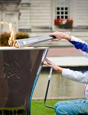 Paralympian cyclist Simon Richardson lights the cauldron in Cardiff