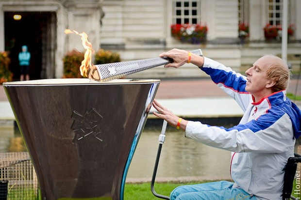 Paralympian cyclist Simon Richardson lights the cauldron in Cardiff