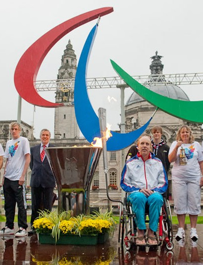 Simon Richardson with officials and members of the GB paralympic team at the lighting of the cauldron in Cardiff on Monday