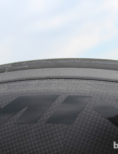 The CXR 80 features a rubber 'blade' that snaps into place between the tire and rim edge for a near-flat profile