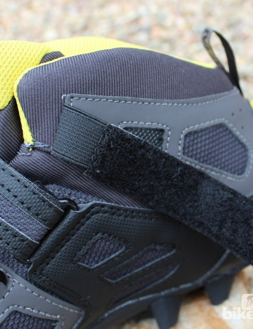 The top Velcro strap on the Scree has elastic at base to move more easily when walking