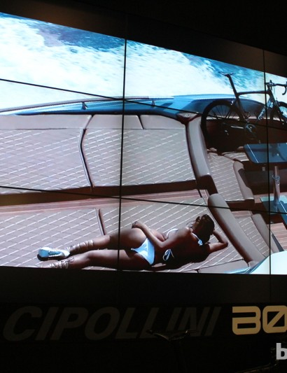 In the Bond video, Cipo was chased by on his bike by cars and motorcycles before he escapes by boat with a woman in a bikini