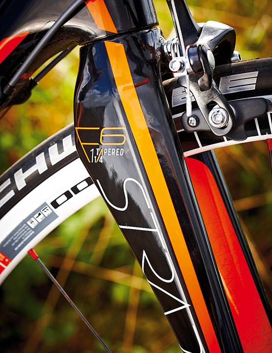 The semi-aero tapered carbon fork helps keep the weight down