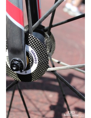 Lightweight does not disclose how the carbon spokes are anchored in the carbon flange